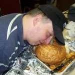 Tom, you're supposed to EAT the hamburger, not sleep on it...