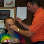 An employee of Alliance EMS fitted Tom with an oxygen mask for a breath of fresh air.