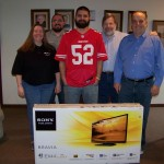 Ray Duran (center) is the winner of the K99.3 Football Pick'Em Contest, surrounded by Anita Goodan, Nathan Welter, Jerry Curtis, and Tom Berg.