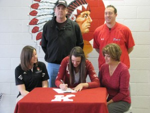 Kaitlin signs her letter of intent.