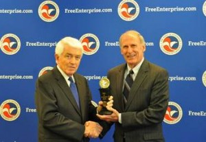 Thomas J. Donohue presents Senator Coats with the award