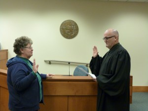 Judge Pat Blankenship administers the oath of office to Judy Heater
