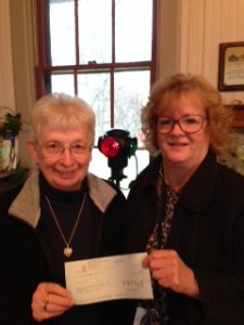 Joan Ludwig of CenturyLink presents a check to Mint Festival President Donna Henry in the amount of $500 for the Mint Queen sponsorship