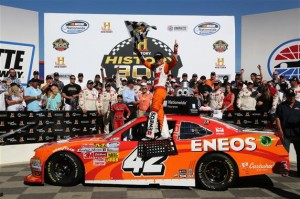 Kyle Larson, driver of the #42 ENOES Chevrolet, celebrates in victory lane after winning the NASCAR Nationwide Series History 300 at Charlotte Motor Speedway on May 24, 2014 in Charlotte, North Carolina. Photo by Jerry Markland/Getty Images