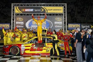 Joey Logano, driver of the #22 Shell Pennzoil Ford, celebrates in Victory Lane after winning the NASCAR Sprint Cup Series Irwin Tools Night Race at Bristol Motor Speedway on August 23, 2014 in Bristol, Tennessee. Photo by Sean Gardner/Getty Images