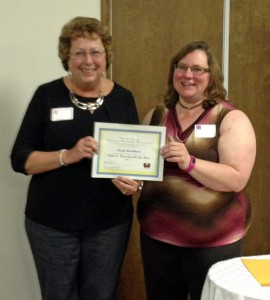 Sue Rosenbaum of Patchwork Pals received the Homemaker of the Year Award.  She is pictured with Karen Good of Country Friends