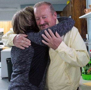 Kid's Closet Ministry Founder and Director Linda Lewandowski hugs Pastor Alvin Allen from Little Dove Baptist Church. Their Oct. 31 rock-a-thon raised $1,200 for the minstry.