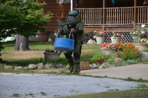 A technician with the Porter County Sheriff's Bomb Squad removed a homemade bomb to a containment trailer. Photo by Capt. Mike Kellems