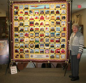 Melba Shilling from the Starke County Historical Society stands proudly next to the Indiana Bicentennial Barn Quilt. Photo provided.