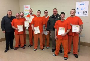 Starke County Therapeutic Community Program Coordinator Leo Smith and Sheriff Bill Dulin pose with the program's first graduates